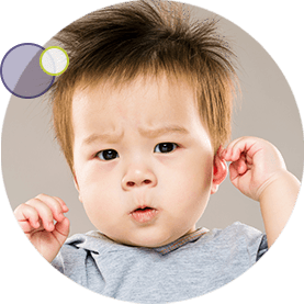 little boy holding his painful ear